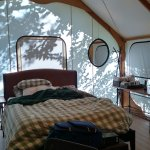 Inside the Canvas Tent - includes queen bed, dining table, couch/pull out bed.