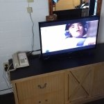 Small flat screen TV with cable.