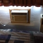 A/C unit right next to the bed.