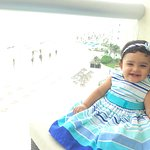 My granddaughter very happy in the balcony!