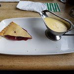Apple and blackberry pie with custard