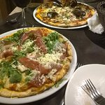 2 pizzas - one with ham from Parma and the other one with sea food!