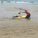 Our son learning all about surfing from Lew Smart and getting some top tips