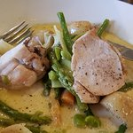 Roast breast of chicken with summer vegetables and lemon thyme butter sauce