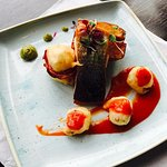 delicious Fillet of salmon, served with chunky chips, tempura scallop and prawn.