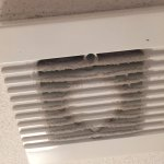 bathroom fan caked with dirt