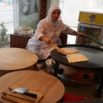 Woman making gozleme in the restaurant