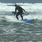Son surfing after a short lesson