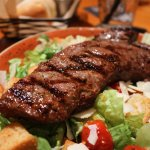 Steak cooked to perfection with salad