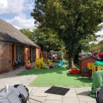 Small outdoors yard with artificial grass