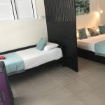 King bed and single bed with a privacy screen.
