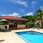 Gazebo by the pool has a large barbecue/grill with a seating area for our guests to use