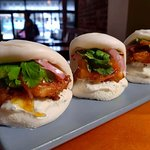 Onion Bhaji Battered Snapper Steamed Buns, with Mint Yoghurt, Pickled Red Onion, & Mango Chutney