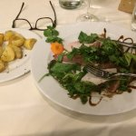 This dish was a thinly sliced beef in greens with delicious roasted potatoes