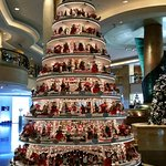 Gorgeous Christmas tree with handmade ornaments in the foyer