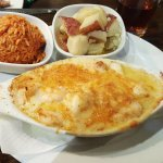 Seafood au Gratin with red rice and red potatoes.