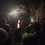 A tour of the wine cellar in the underground tunnel.