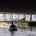 Kayak passing under the bridge