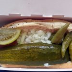 a Superdawg with pickled tomato, a pickle slice and sport peppers