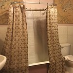 Huge Gone with the Wind Bathroom 1 side. Other side large walk-in shower &antique armoire