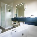 1 & 2 Bedroom Units - Bathroom with Shower and Spa Bath