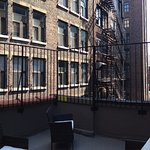"Room 1004 features a furnished private roof deck - well, as ""private"" as such things are in New"