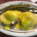 Eggs Benedict with asparagus.