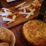 cheese platter, warm bread, tortilla de patata