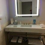 """Bathroom mirror has purple """"nightlight"""" LED frame."""