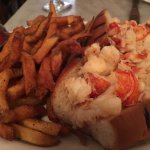 Hot lobster roll with butter and a side of fries