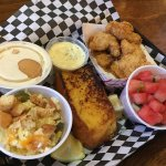 Catfish platter comes with 2 sides, cornbread, drink for $11 and change.  Ordered an extra side
