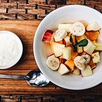 Fresh fruit salad with natural yoghurt for breakfast