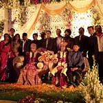 Attending a marriage function in the outside lawn area of Clarks Avadh