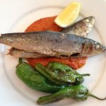 Whole roast sardines with romesco sauce and padron peppers.