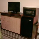 TV, microwave, and fridge