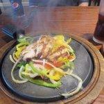 steaming chicken fajitas
