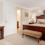 Room #8, E. Haliwell Studio, deluxe queen room with a full amenity center