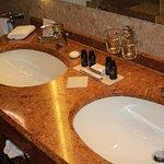 Beautiful marble sinks in large bathroom
