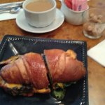 Egg and bacon on croissant.
