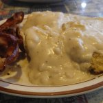 Half order of biscuits and gravy with a side order of bacon