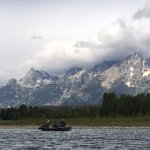 The Tetons in the morning light. The only other boat on this 2 hour trip was a fishing guide.