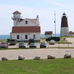 Point Judith Lighthouse atop the hill overlooking the parking lot.