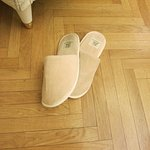 House shoes after the cleaning lady has left the room