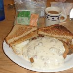 Chicken Fried Steak with hash browns eggs, toast and sausage gravy