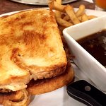 Adult grilled cheese on sourdough with pulled roast beef, frizzled onions