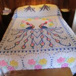 Chenille bedspread with dual peacock design.