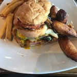 Cubano sandwich with fried plantains and French fries