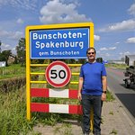 My husband posing for his photo op outside of Buschoten-Spakenburg. Our last name is Benscoter.