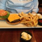 Traditional burger (seasoned and grilled with cheese, lettuce, tomato) with fries