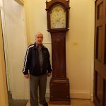 dad by one of the clocks